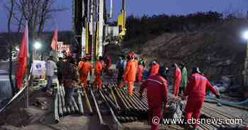 Chinese miners will be trapped for at least 15 more days, city says