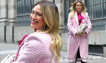 Hilary Duff bundles up her bump in baby pink as she gets to work in New York City