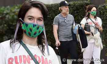 Game Of Thrones' Lena Headey wears a Run-DMC T-shirt as she and her boyfriend Marc Menchaca work out