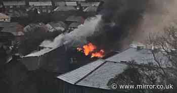 Firefighters tackle school blaze as flames and thick smoke pour from roof