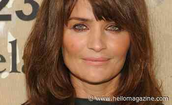 Helena Christensen's physique is unbelievable in multi-coloured swimsuit during tropical vacation