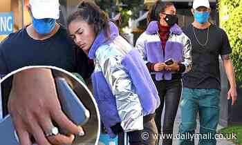 Kelly Gale shows off her diamond engagement ring as she steps out with fiance Joel Kinnaman