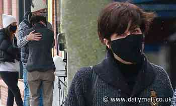 Selma Blair shares a tender moment with beau Ron Carlson during rainy day shopping trip in LA
