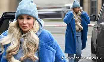 Olivia Attwood cuts a casual figure in a baby blue ensemble as she heads out in Manchester