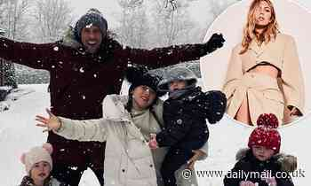 Abbey Clancy and Peter Crouch take a walk in the snow with their four children