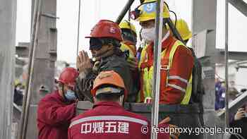 Eleven Chinese miners saved as rescuers race to find remaining ten