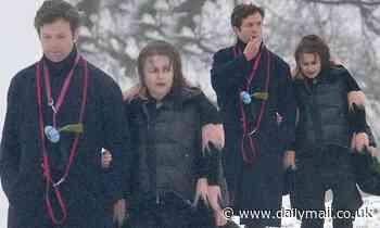 Helena Bonham Carter, 54, wraps up warm in a padded jacket alongside her beau Rye Dag Holmboe, 32