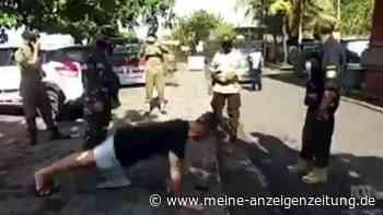 Ungewöhnliche Strafe für Maskenverweigerer: Polizei auf Bali verdonnert Touristen zu Liegestützen
