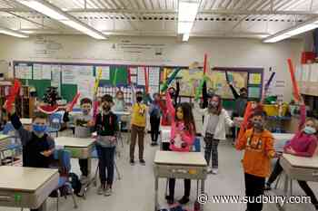 École St-Étienne students try out 'boomwhackers' in music class