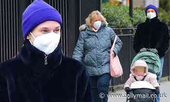 Diane Kruger is stylish in black jacket and blue beanie on outing with her mom and daughter in NYC