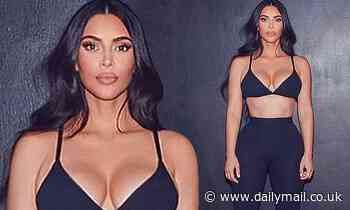 Kim Kardashian is her own best advert as she shows off hourglass figure in Skims ensemble