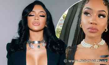 Saweetie sets pulses racing as she poses topless beneath a black blazer in jaw-dropping snap