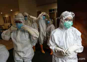 Indonesia reports record daily increase in coronavirus deaths - Reuters