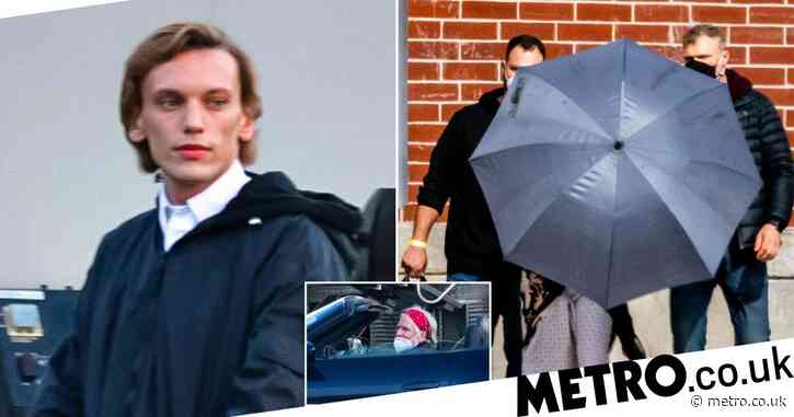 Millie Bobby Brown hides behind umbrella as she's spotted in hospital gown on set of Stranger Things season 4