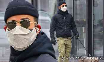 Justin Theroux bundles up in a beanie and leather gloves while taking his dog for a walk in New York
