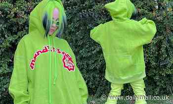 Billie Eilish goes green as she poses on Instagram in neon hoodie and pants that match her dyed hair