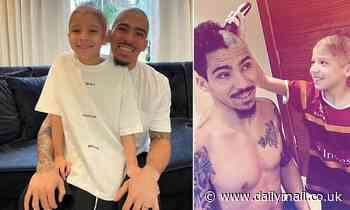 Allan poses after alopecia-suffering son shaves off his hair