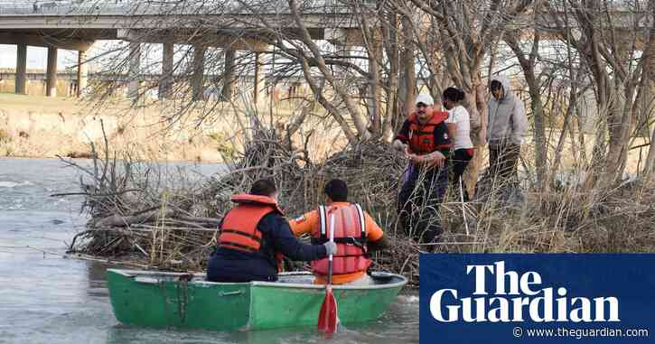 Eight-year-old boy dies as migrants risk Arctic conditions to cross river into US