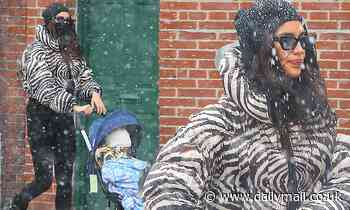 Irina Shayk gets caught in a snowstorm in New York City while pushing her daughter Lea's stroller