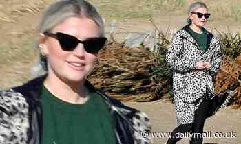 Coronation Street star Lucy Fallon looks cool in an animal print coat as she enjoys walk with dog