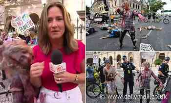 Bizarre moment climate protester dressed as a zombie BITES Sunrise reporter during a live TV cross
