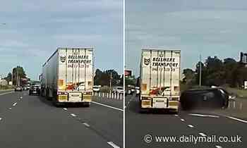 Horror moment a truck swipes a tiny car on a busy highway