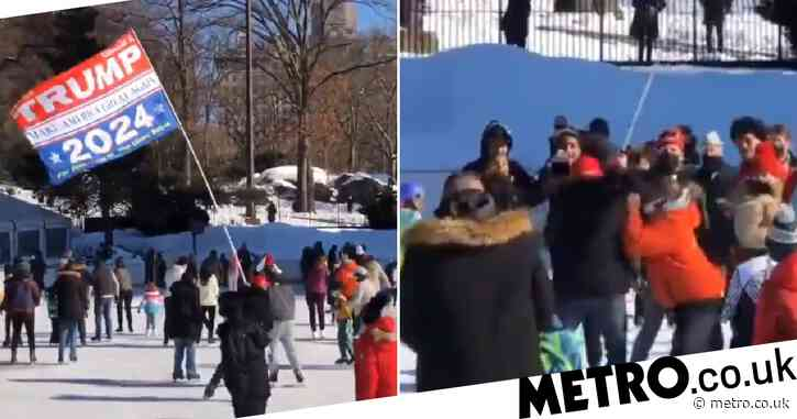 Crowd cheers as ice skater carrying 'Trump 2024' flag is tackled to the ground