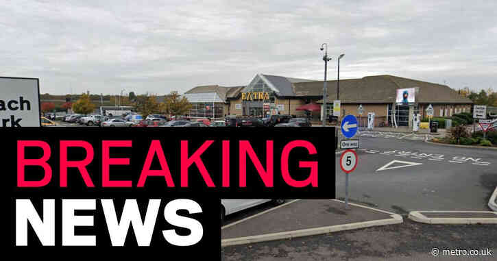 18 people rescued from back of refrigerated lorry at service station
