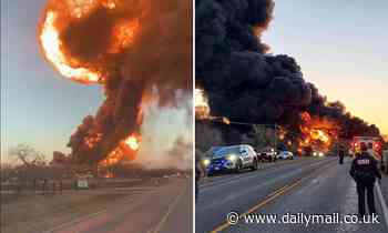 Explosion as train carrying oil tankers crashes into truck in Texas