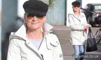 Anthea Turner flashes a broad smile as she is seen for the first time since flouting lockdown rules