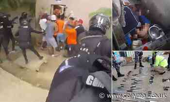 More than 50 inmates killed in riots sparked by rival gangs at three prisons in Ecuador