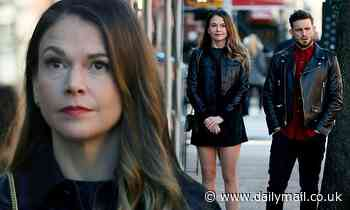 Younger stars Sutton Foster and Nico Tortorella wear black leather jackets as they filmin New York