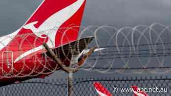 Qantas posts $1 billion six-month loss