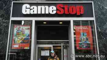 GameStop rebounds in final hour, Dow climbs to new record as Aussie dollar hits three-year high