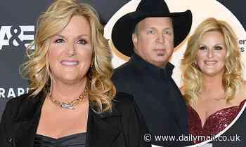 Garth Brooks says wife Trisha Yearwood has tested positive for coronavirus as he's tested negative