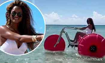 Ciara looks sensational in a white swimsuit as she makes a grand statement on the beach