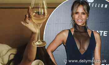 Halle Berry drinks wine in bed after inking deal to star in Netflix sci-fi adventure The Mothership