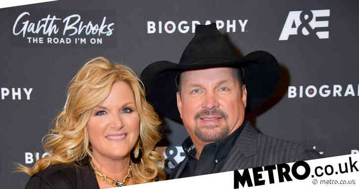 Country singer Trisha Yearwood, 56, contracts Covid-19 as husband Garth Brooks says 'we'll ride through this'
