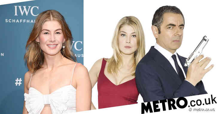 Rosamund Pike calls out Johnny English Reborn movie poster for 'augmenting' her breasts