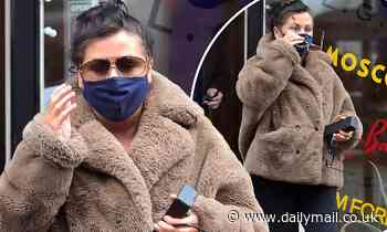 EastEnders' Jessie Wallace jazzes up her ensemble with a faux fur coat as she goes shopping in style