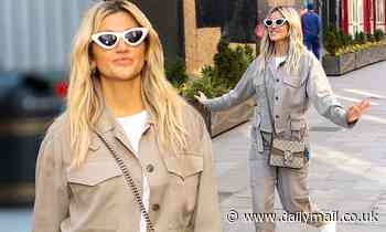 Ashley Roberts wears a beige jacket and matching cargo trousers as she leaves work at Heart Radio