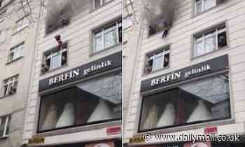 Moment mother saves her four children by throwing them from the third floor of a burning building