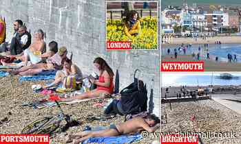 Lockdown-weary Brits hit the beach and bask in 55F sunshine