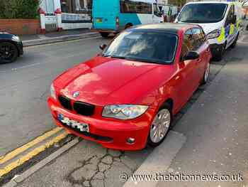 Red BMW seized by Bolton police after driver reportedly had no licence