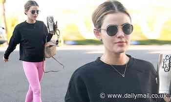 Lucy Hale slips into bubblegum pink leggings as she steps out in sunny Los Angeles for a workout