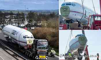 Old Boeing 727 crawls along motorway after entrepreneur snaps up jet to use as his new offices
