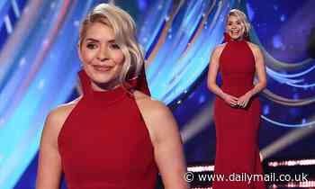 Holly Willoughby exudes glamour in a figure-hugging red gown as she returns to Dancing On Ice