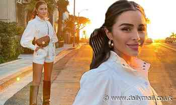 Olivia Culpo looks radiant against the setting sun in a series of Instagram snaps in Santa Monica