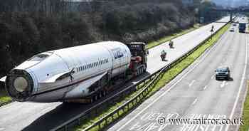 Enormous Boeing plane stops traffic as it is driven on motorway to new home