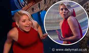 Holly Willoughby screams as a dinosaur sneaks up on her during Dancing On Ice